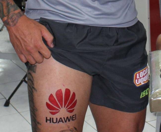 A bogus tattoo on the leg of Canberra Raiders footballer Sandor Earl, sent by Huawei as an Apr Fool
