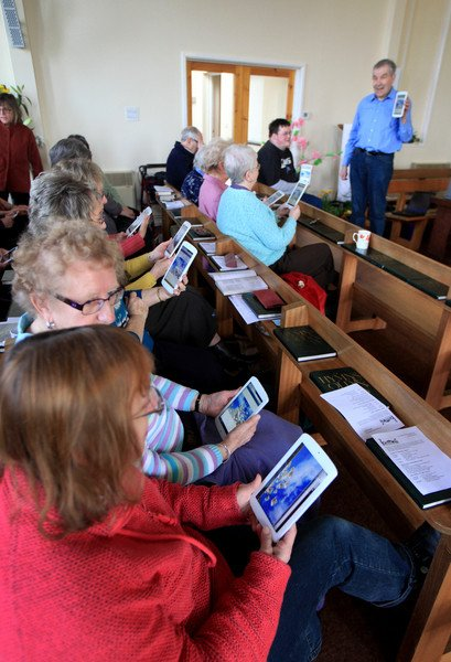 Elderly church-goers embracing tablet technology