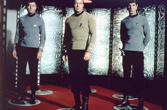 Bones, Kirk and Spock prepare to transport in Star Trek