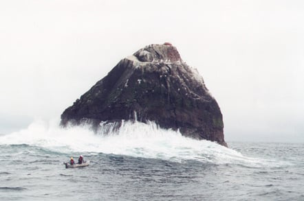 The inflatable approaches a swell-lashed Rockall in 2003