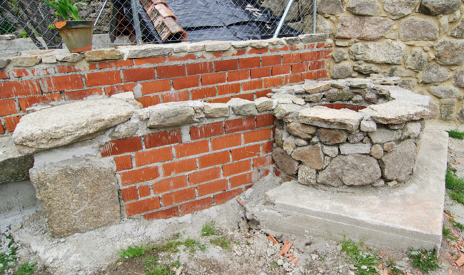 The well faced in stone, and nearly done