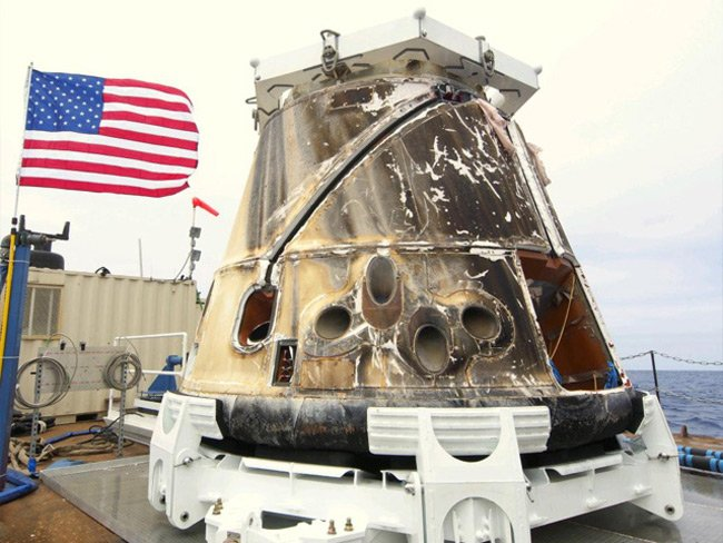 SpaceX's Dragon spacecraft on the barge after being retrieved from the Pacific Ocean after splashdown, May 31, 2012. Photo: SpaceX