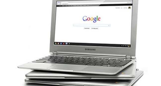 Photo of a stack of Google Chromebooks