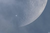 ISS against a spring moon