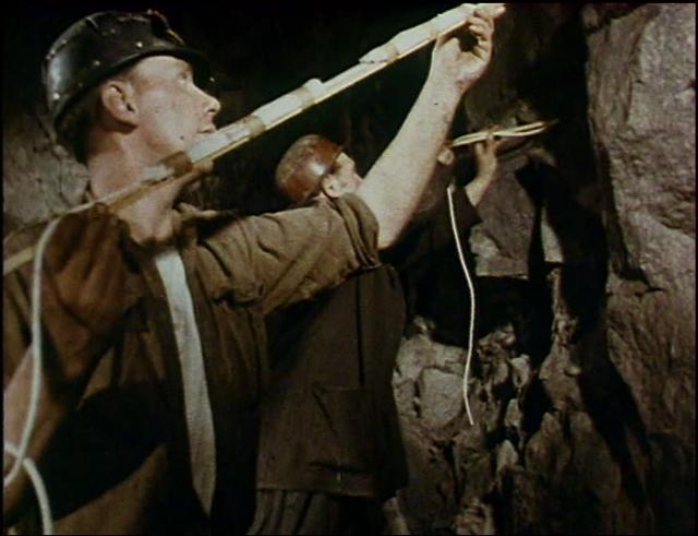 Men placing explosives