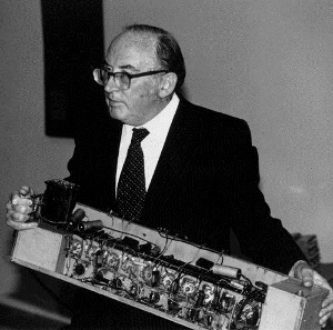 Sir Maurice Wilkes holds computer component