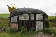 Alex Holland's boat-roofed shed