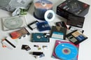 Data storage everywhere - CD, DVD, DAT, DCC, HDD, MiniDisc, SSD, SD card, floppy, magnetic stripe, barcode