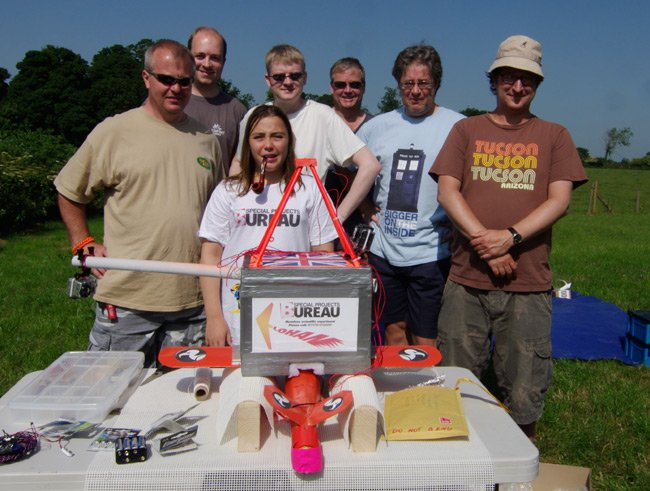 The test flight team pose with the payload before the flight