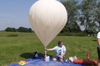 Dave Akerman inflates the balloon