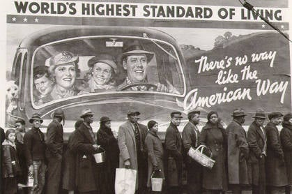 Americans queuing for free bread under a banner reading: World's highest standard of living ... the American way