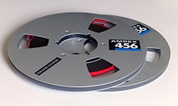 Audio tape reels feature flanges to hold the tape in place and protect it