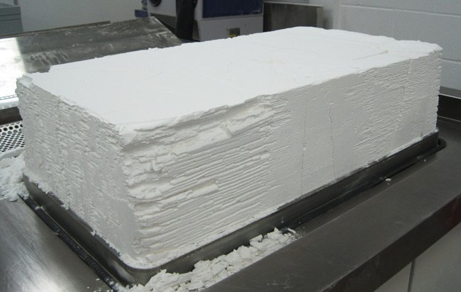 The block of nylon powder as it emerges from the 3D printing machine