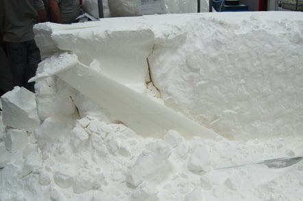 The wing begins to emerge from the nylon powder