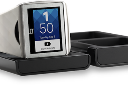 Qualcomm's Toq smartwatch in its charger slash case