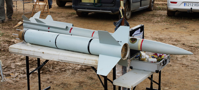 A two-stage rocket before assembly