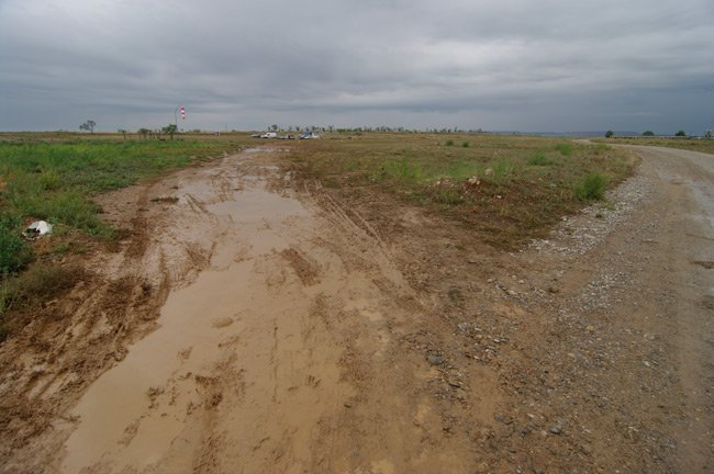 The muddy entrance to the launch site