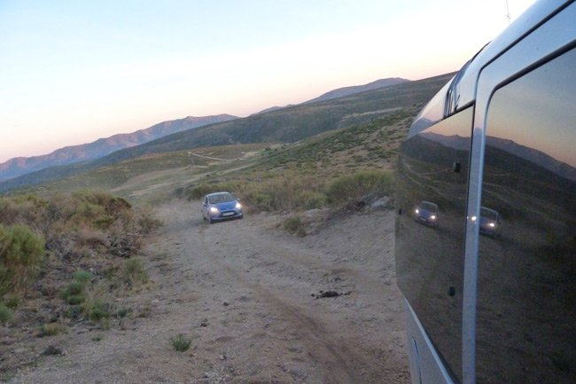One of our pursuit cars seen from the other as we ascend a dirt track