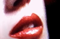 Close-up of a woman's lips, slightly pixelated as if on a CRT TV