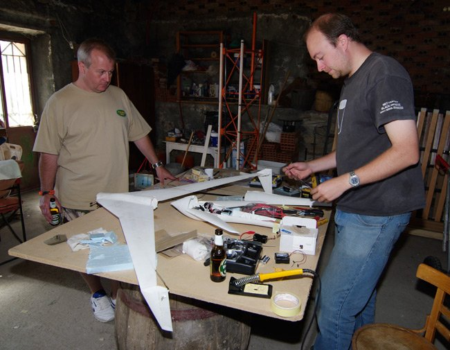 Rob Eastwood and Paul Shackleton contemplate the Vulture 2 inside the workshop