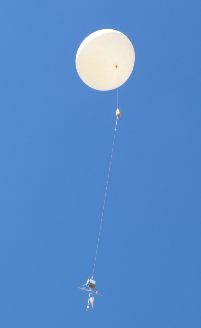 The balloon and payload in the air just after launch