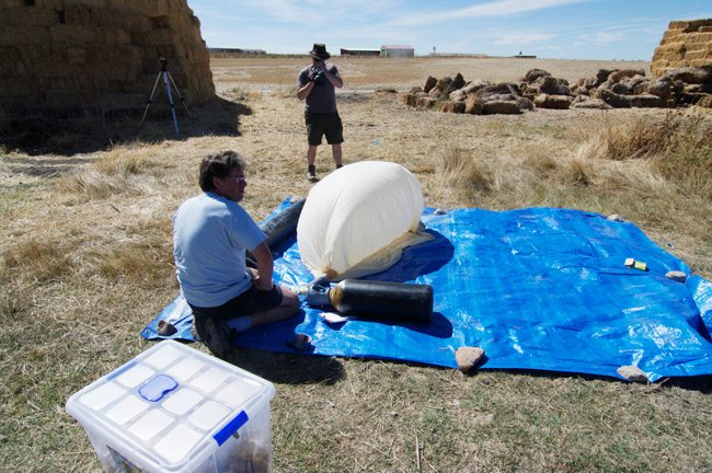 Dave Akerman begins to fill the balloon
