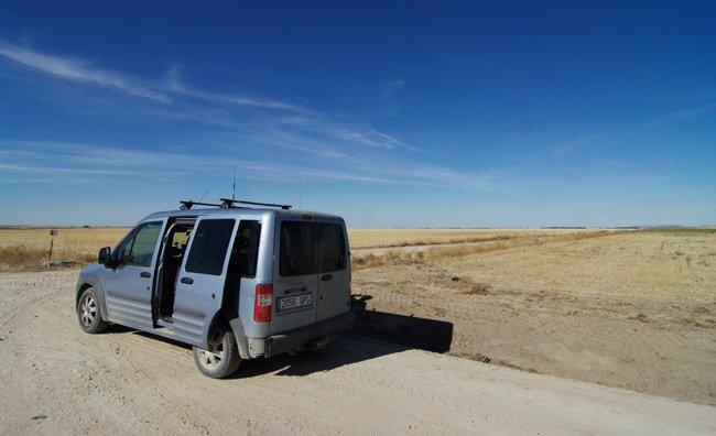 The pursuit van parked in the middle of a vast plain as we wait for the payload to land
