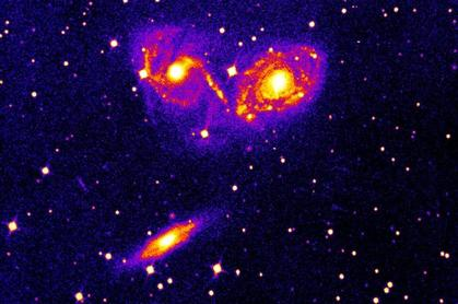 Photographic plate image of the colliding galaxies NGC 6769, 6770, and 6771.