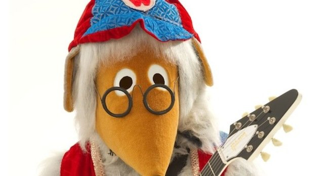 A Womble holding a guitar