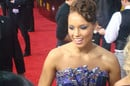 Alicia Keys at a red carpet event in a blue, jewelled gown with upswept hairdo. Photo by Keith Hinkle, licensed under creative commons attribution