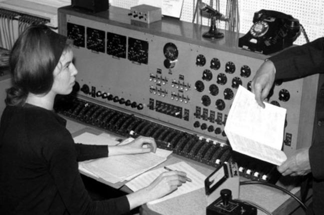 Delia Derbyshire behind the custom built 20-channel mixing desk