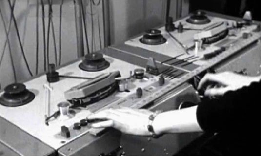 Delia Derbyshire plays a tape loop on a Philips EL3503