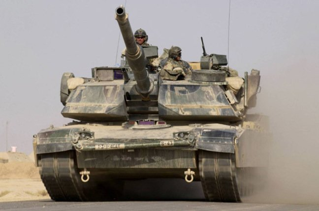 A US Army M1A1 Abrams tank heads out on a mission from Forward Operating Base MacKenzie in Iraq on October 27, 2004