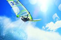 Windsurfer mid-flight (3CX logo in sail)