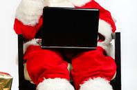 Santa Claus on his laptop