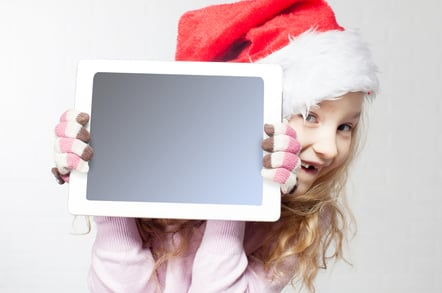 Happy child at Christmas with a tablet