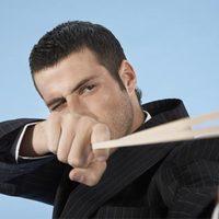 Man pinging back elastic band