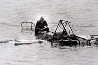 Pilot atop sinking vintage aircraft