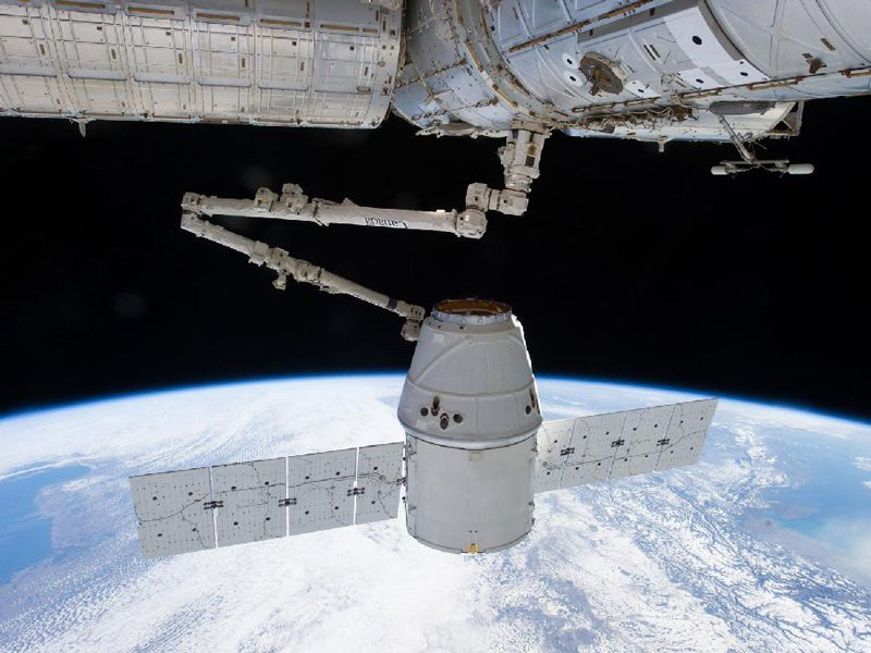 The Dragon capsule grabbed by the ISS's robotic arm in March 2013