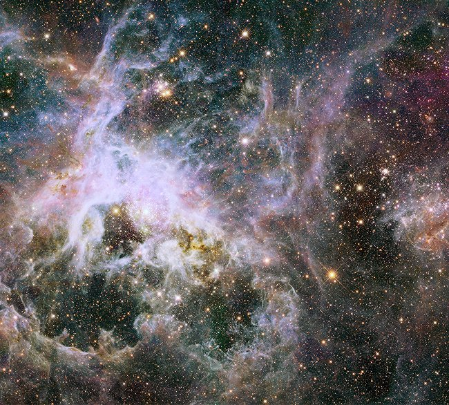 The Hubble mosaic, spanning a width of 600 light-years, of a star factory of more the 800,000 stars being born inside the Tarantula Nebula.