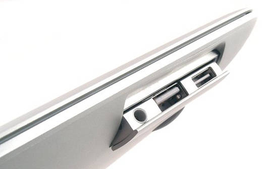 Flip-down port door on the original MacBook Air