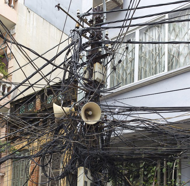 Tangle of cables attached to a telegraph pole