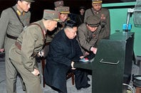 Photo of Kim Jong-un using an archaic computer
