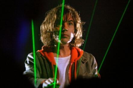 Jean Michel Jarre performs (green lasers in background). Photo by Daniele Dalledonne