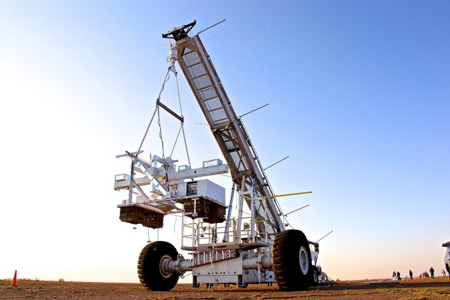 The Wallops Arc Second Pointer (WASP) payload suspended from a crane during a test deployment