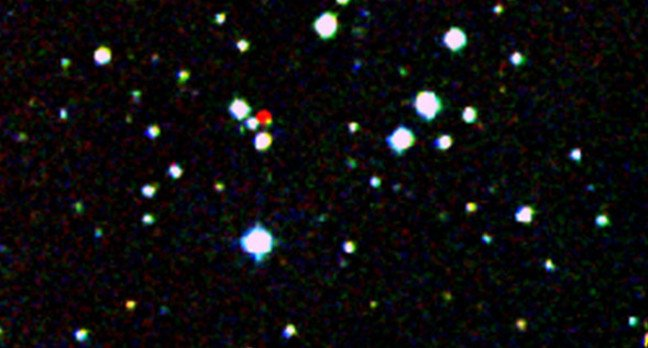 A nearby star stands out in red in this image from the Second Generation Digitized Sky Survey by WISE