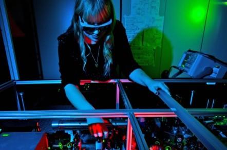 ANU student with quantum comms apparatus