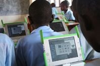The One Laptop Per Child project: kids at the Kagugu Primary School, Kigali, Rwanda, get to grips with new computers
