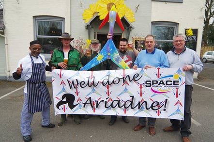 The Space Graphics Solutions team poses with the wrapped Vulture 2