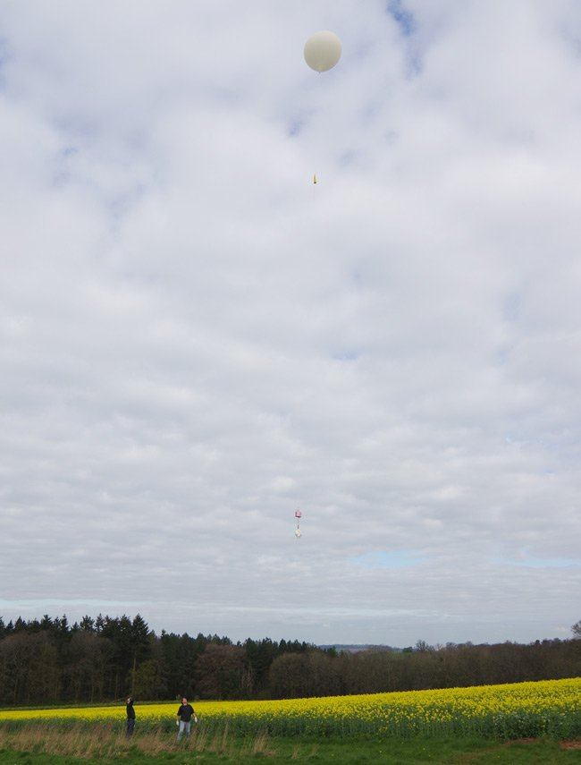 The balloon and payload rise into the air
